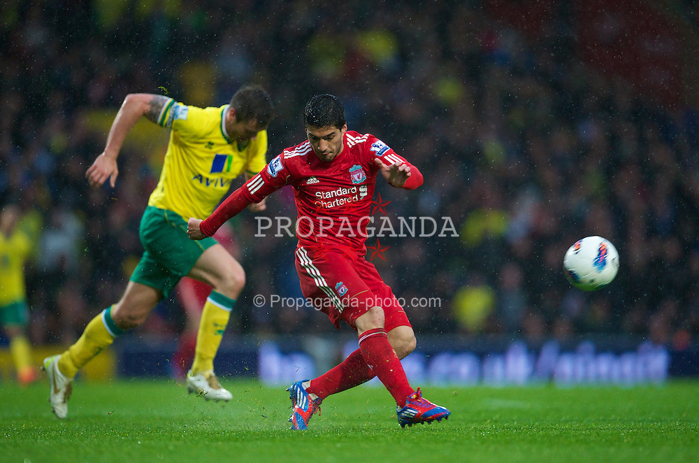 NORWICH, ENGLAND - Saturday, April 28, 2012: Liverpool's Luis Alberto Suarez Diaz score his hat-trick goal from 40-yards out against Norwich City during the Premiership match at Carrow Road. (Pic by David Rawcliffe/Propaganda)