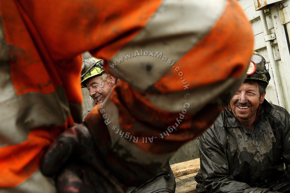 Gwyn Evans, 48, (left) and  Keith Aubrey, 56, (right) miners working to restore Unity Mine, are joking with each others while taking a break on the surface, on Friday, Apr. 13, 2007, in Cwmgwrach, Vale of Neath, South Wales. The time is ripe again for an unexpected revival of the coal industry in the Vale of Neath due to the increasing prize and diminishing reserves of oil and gas, the uncertainties of renewable energy sources, and the technological advancement in producing energy from coal while limiting emissions of pollutants, has created the basis for valuable investment opportunities and a possible alternative to the latest energy crisis. Unity Mine, in particular, has started a pioneering effort to revive the coal industry in the area, reopening after more than 8 years with the intent of exploiting the large resources still buried underground. Coal could be then answer to both, access to cheaper and paradoxically greener energy and a better and safer choice than nuclear energy as a major supply for the decades to come. It is estimated that coal reserves in Wales amount to over 250 million tonnes, or the equivalent of at least 50 years of energy supply, while the worldwide total coal could last for over 200 years as a viable resource compared to only a few decades of oil and natural gas.