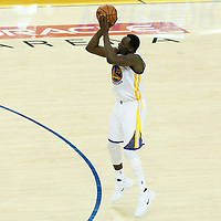 12 June 2017: Golden State Warriors forward Draymond Green (23) takes a jump shot during the Golden State Warriors 129-120 victory over the Cleveland Cavaliers, in game 5 of the 2017 NBA Finals, at the Oracle Arena, Oakland, California, USA.