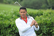 John Salako watches over his shot during the Julian Speroni Testimonial Golf Day at the Surrey National Golf Club, Chaldon, United Kingdom on 9 September 2015. Photo by Michael Hulf.