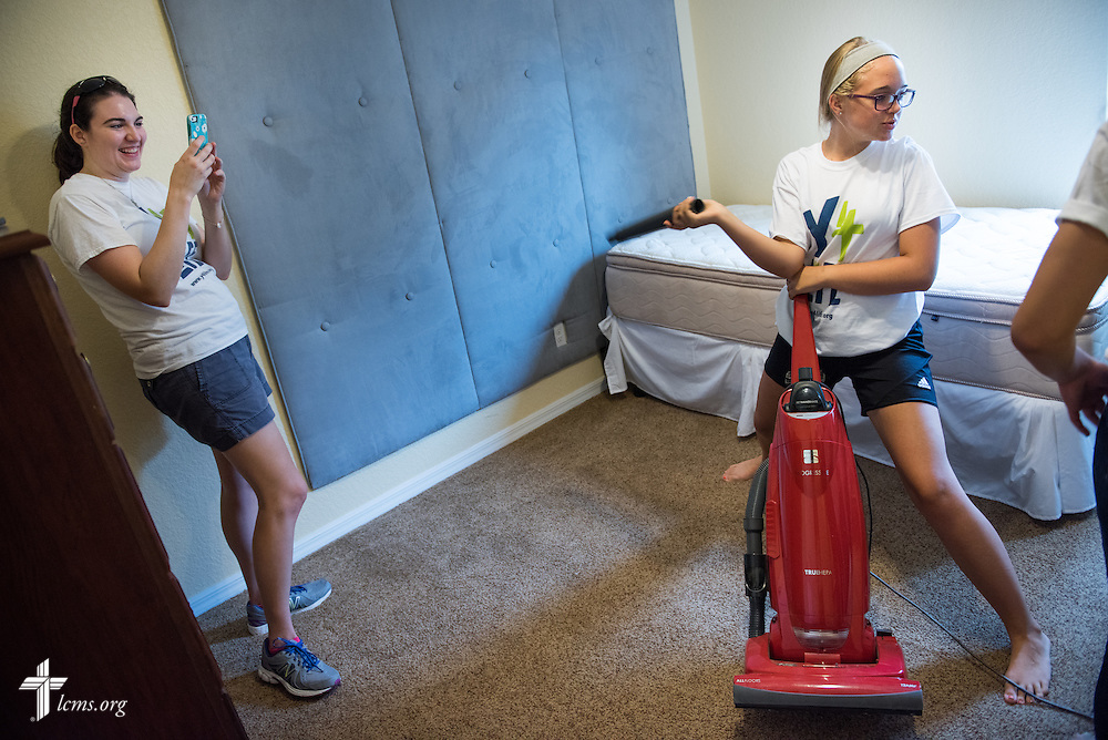 Laura Davis (left), development counselor and director of Y4Life at Lutherans for Life, films student volunteer Morgan Sims in a humorous moment of housecleaning at Redeeming Life Maternity Home during a Y4Life servant event on Saturday, Sept. 12, 2015, in Sanford, Fla. LCMS Communications/Erik M. Lunsford