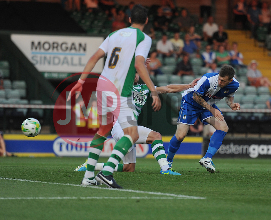 Bristol Rovers Jamie White heads towards gol but is saved by Yeovil Town's Christoper Weale  - Photo mandatory by-line: Alex James/JMP - Tel: Mobile: 07966 386802 15/07/2014 - SPORT - FOOTBALL - Huish Park - Yeovil  -  Yeovil Town V Bristol Rovers  - preseason