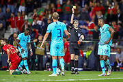 Netherlands defender Denzel Dumfries (22)  receives a yellow card for the tackle on Portugal midfielder Rafa Silva (15) during the UEFA Nations League match between Portugal and Netherlands at Estadio do Dragao, Porto, Portugal on 9 June 2019.