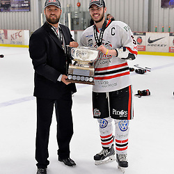 FORT FRANCES, ON - May 2, 2015 : Central Canadian Junior &quot;A&quot; Championship, game action between the Fort Frances Lakers and the Soo Thunderbirds, Championship game of the Dudley Hewitt Cup. Jordan Smith Head Coach of the Soo Thunderbirds and team captain Anthony Miller #15 with the Dudley Hewitt Cup.<br /> (Photo by Shawn Muir / OJHL Images)