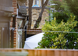 FILE PICTURE © Licensed to London News Pictures. 21/09/2017. London, UK. A police evidence tent is seen in the back garden of a house belonging to Sabrina Kouider and her partner Ouissem Medouni where police and the fire brigade attended and found the burnt body of their nanny Sophie Lionnet in the garden in Wimbledon, south London. Kouider and Medouni, who are both French nationals, deny murder but have admitted perverting the course of justice by burning the body. Photo credit: Peter Macdiarmid/LNP
