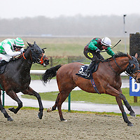 Seek The Fair Land and William Carson winning the 2.00 race