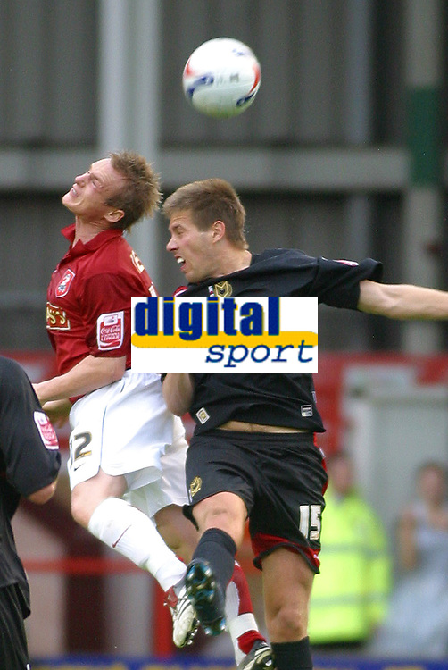 Photo: Dave Linney.<br />Walsall v Milton Keynes Dons. Coca Cola League 2. 28/10/2006. Walsall's Dean Keates(L) rises highest to beat  Gareth Edds  to the ball.