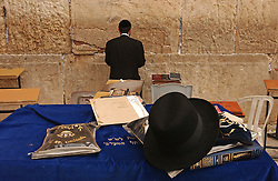 JERUSALEM, ISRAEL - MAY-09-2004 - The faithful pray at the Western Wall in the Jerusalem's Old City. (PHOTO © JOCK FISTICK)