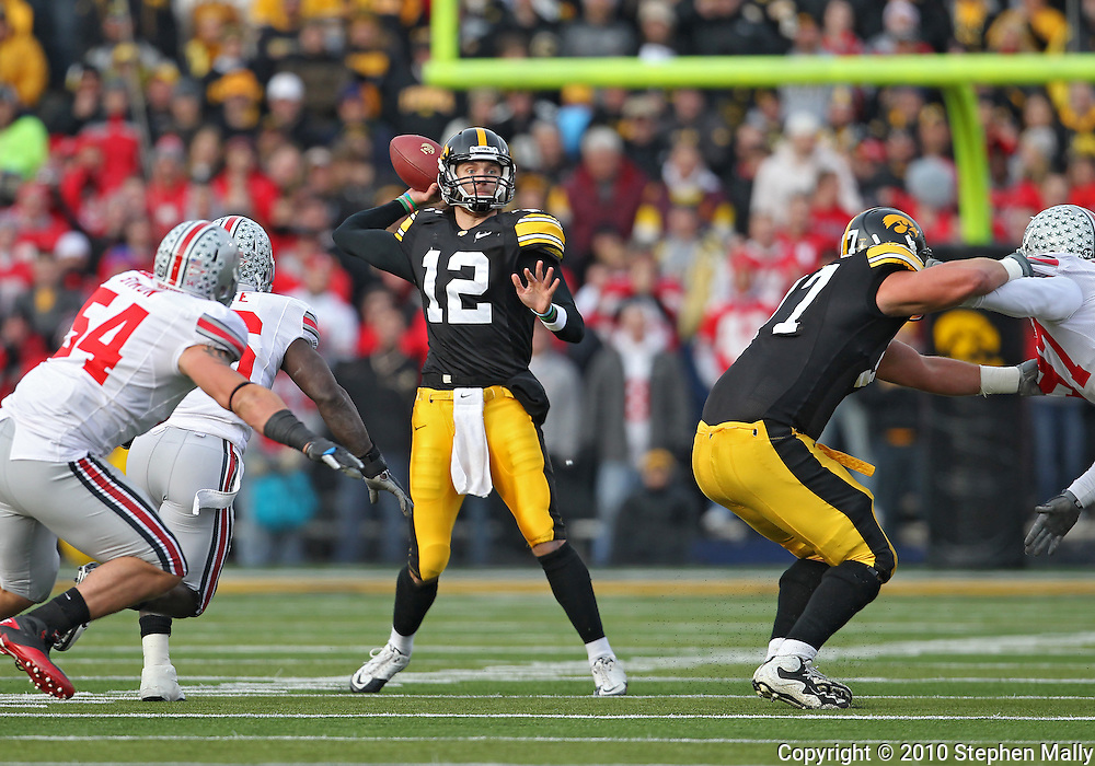 November 20 2010: Iowa Hawkeyes quarterback Ricky Stanzi (12) eyes a receiver during the first quarter of the NCAA football game between the Ohio State Buckeyes and the Iowa Hawkeyes at Kinnick Stadium in Iowa City, Iowa on Saturday November 20, 2010. Ohio State defeated Iowa 20-17.