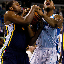 December 17, 2010; New Orleans, LA, USA; New Orleans Hornets point guard Jarrett Jack (2) gets tied up with Utah Jazz small forward C.J. Miles (34) during the second half at the New Orleans Arena.  The Hornets defeated the Jazz 100-71. Mandatory Credit: Derick E. Hingle