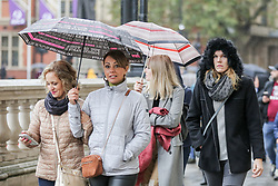 © Licensed to London News Pictures. 01/11/2019. London, UK. Members of the public shelter from the rain underneath umbrellas on a wet and milder November day in Westminster, London. Photo credit: Dinendra Haria/LNP