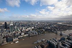 © Licensed to London News Pictures. 10/10/2013. London, UK. After awaking to a fresh and chilly Autumnal morning, the River Thames, Tower Bridge and the City of London are seen from the top of the Shard in London today (10/10/2013). Photo credit: Matt Cetti-Roberts/LNP