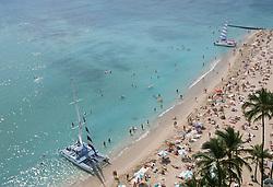 Crowded beach in Waikiki, Hawaii