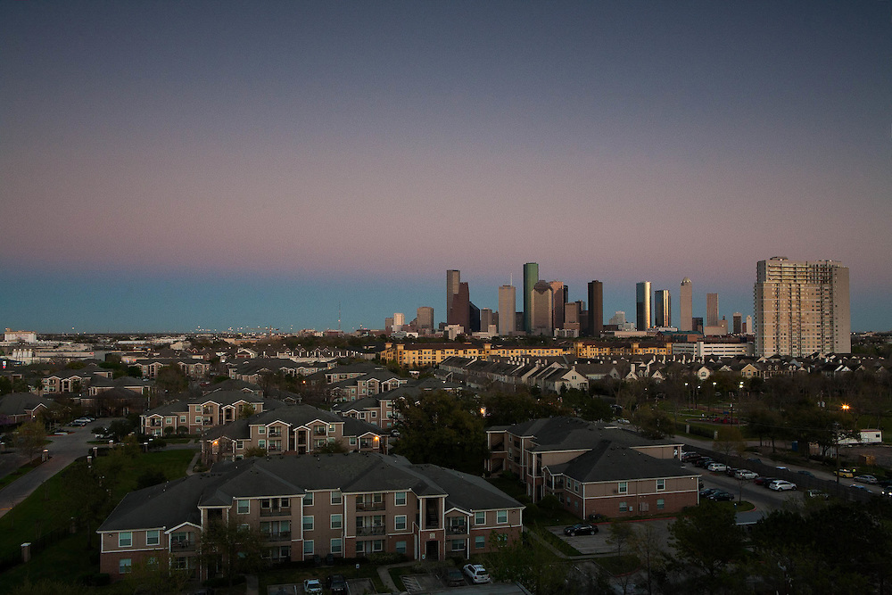 Aerial view of  Houston, Texas skyline at twilight from the west with residential neighborhood in foreground.