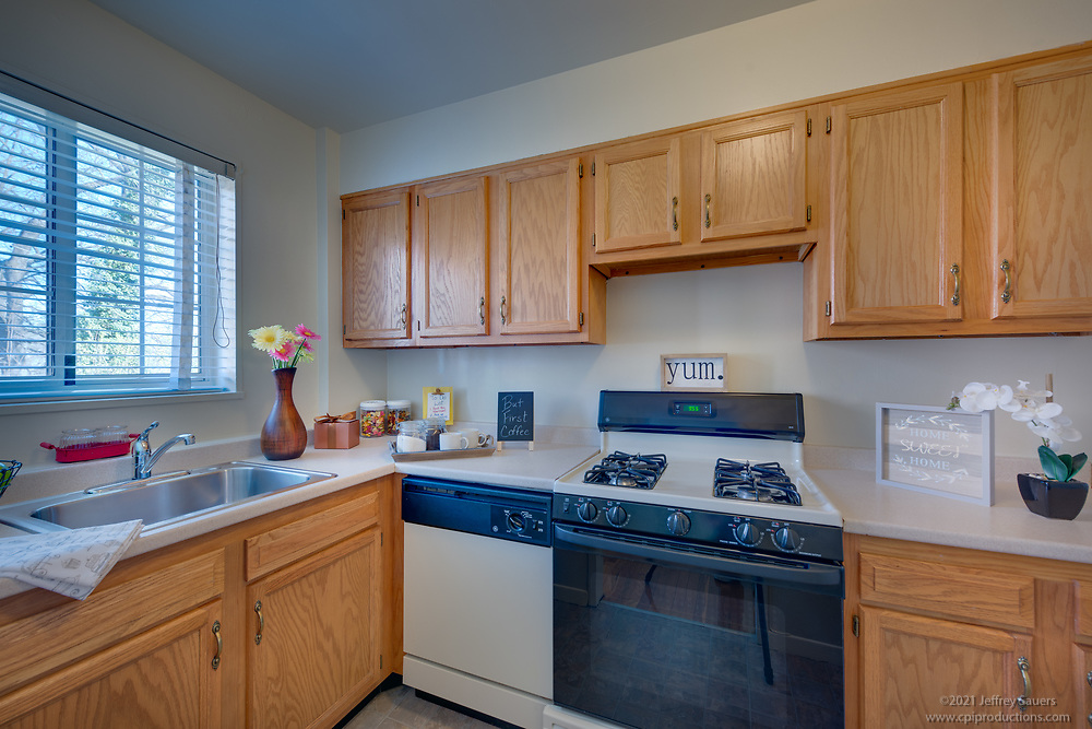Interior photo of kitchen at The Admiralty Apartments In Arlington VA by Jeffrey Sauers of Commercial Photographics, Architectural Photo Artistry in Washington DC, Virginia to Florida and PA to New England
