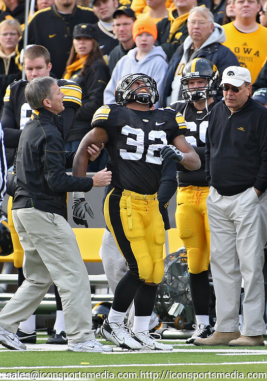 November 21, 2009: Iowa running back Adam Robinson (32) is helped by medical staff after being injured on a play during the first half of the Iowa Hawkeyes 12-0 win over the Minnesota Golden Gophers at Kinnick Stadium in Iowa City, Iowa on November 21, 2009.