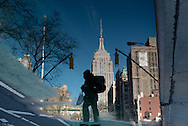 New York .Broadway and 23rd street, the empire state building reflected  in water