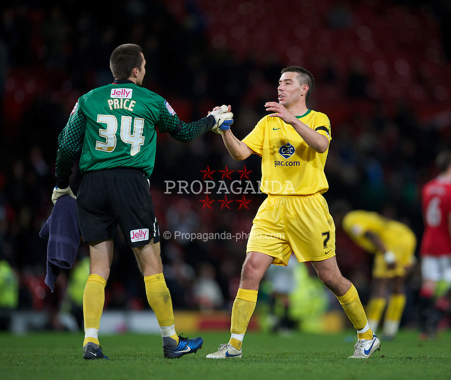 MANCHESTER, ENGLAND - Wednesday, November 29, 2011: Crystal Palace's Welsh goalkeeper Lewis Price celebrates his side's 2-1 extra-time victory over Manchester United with goal-scorer Darren Ambrose during the Football League Cup Quarter-Final match at Old Trafford. (Pic by David Rawcliffe/Propaganda)