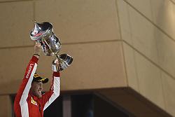 April 8, 2018 - Sakhir, Kingdom of Bahrain - SEBASTIAN VETTEL of Scuderia Ferrari celebrates after winning the 2018 FIA Formula 1 Bahrain Grand Prix at Bahrain International Circuit in Sakhir, Kingdom of Bahrain. (Credit Image: © James Gasperotti via ZUMA Wire)
