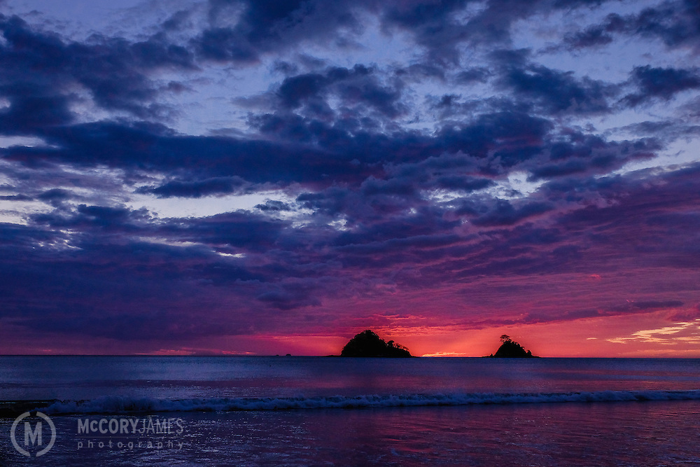 Looking at the sunset behind the islands off the coast of Playa Danta in Costa Rica.