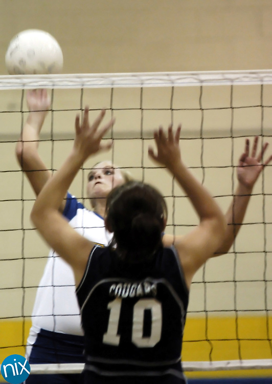 Mount Pleasant's Candice Haffer goes to kill the ball against Central Academy of Technology and Arts' Caty Eggert Monday night in Mount Pleasant.