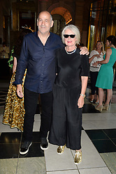 BETTY JACKSON and DAVID COHEN at the opening of Club To Catwalk: London Fashion In The 1980's an exhibition at The V&A Museum, London on 8th July 2013.