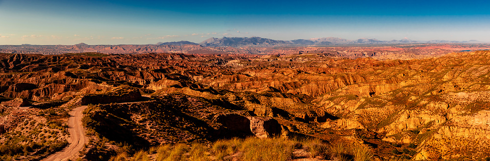 Panoramic view of canyons, Gorafe Depression, Gorafe Megalithic Park, near Gorafe, Granada Province, Andalusia, Spain.