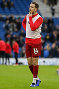 Liverpool midfielder Jordan Henderson (14) in warm up during the Premier League match between Brighton and Hove Albion and Liverpool at the American Express Community Stadium, Brighton and Hove, England on 12 January 2019.