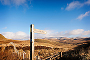 AW signpost with Moffat Hills in the bakcground and blue sky