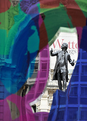 © under license to London News Pictures. LONDON, UK  17/05/2011. The sculpture of Sir Joshua Reynolds seen through 'Coloring Book' by artist Jeff Koons which was unveiled today (17 May 2011), ahead of the Summer Exhibition, in the Royal Academy's Annenberg Courtyard. Jeff Koons was elected Honorary Royal Academician in 2010. Photo credit should read Stephen Simpson/LNP.