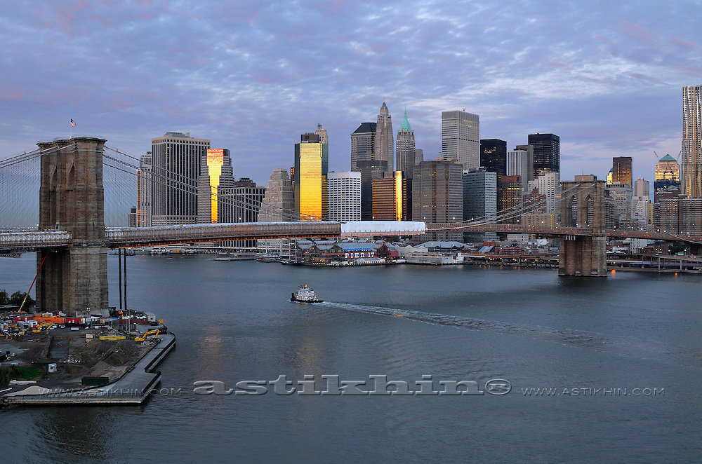 Reflection of sunrise on East River. NYC.