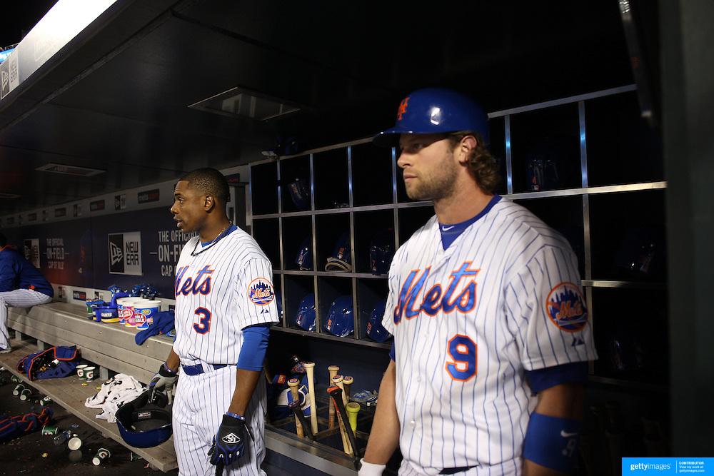 Curtis Granderson, (left) and Kirk Nieuwenhuis, New York Mets, preparing to bat in the dugout during the New York Mets Vs Atlanta Braves MLB regular season baseball game at Citi Field, Queens, New York. USA. 22nd September 2015. Photo Tim Clayton