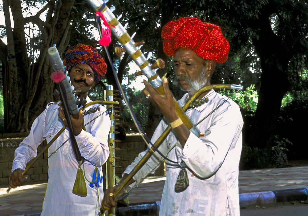 Two Bhopa priest singers perform on their rawanhatha, bowed string instruments, singing the traditional epic.