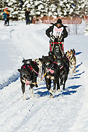 Musher Lance Mackey competing in the Fur Rendezvous World Sled Dog Championships at Campbell Airstrip in Anchorage in Southcentral Alaska. Winter. Afternoon.