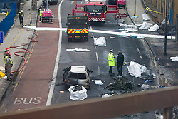 © Licensed to London News Pictures. 17/01/2013. London, UK. Wreckage is seen in a road near Vauxhall after a helicopter hit a crane attached to the St George's Wharf development in Vauxhall, London, yesterday (17/01/13). 2 (two) people, including the pilot, died as a result of the incident and a further 11 (eleven) injured after the Augusta 109 helicopter collided with the crane in heavy mist showering wreckage onto cars below. Photo credit: Matt Cetti-Roberts/LNP