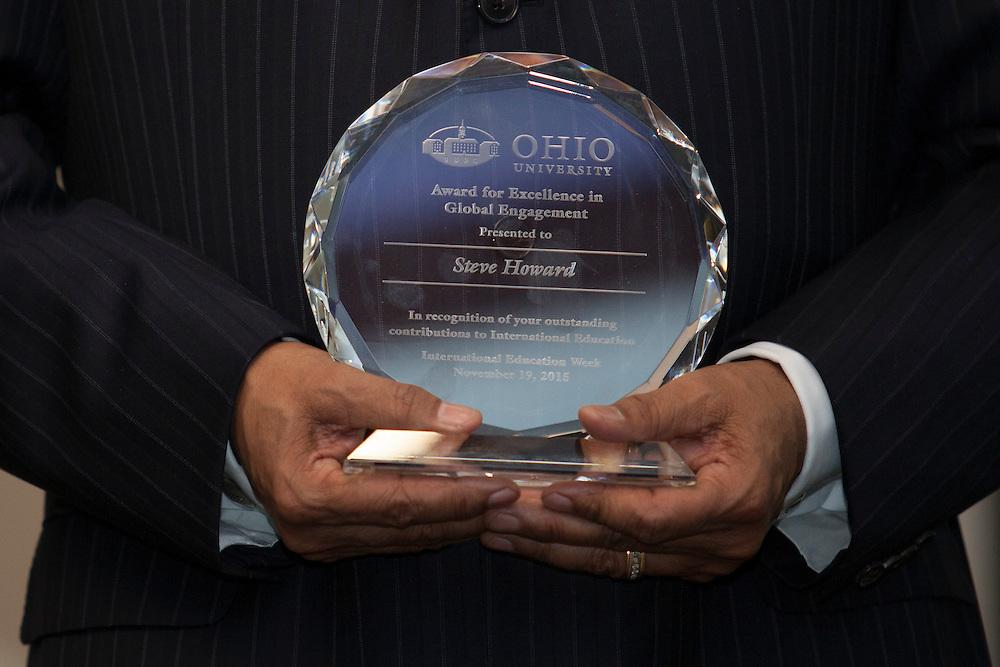 President Roderick McDavis holds an award for Dr. Steve Howard in Nelson Commons on Thursday, November 19, 2015. Photo by Kaitlin Owens