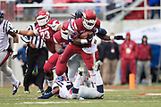 FAYETTEVILLE, AR - NOVEMBER 22:  Alex Collins #3 of the Arkansas Razorbacks runs the ball in the second quarter against the Ole Miss Rebels at Razorback Stadium on November 22, 2014 in Fayetteville, Arkansas.  (Photo by Wesley Hitt/Getty Images) *** Local Caption *** Alex Collins
