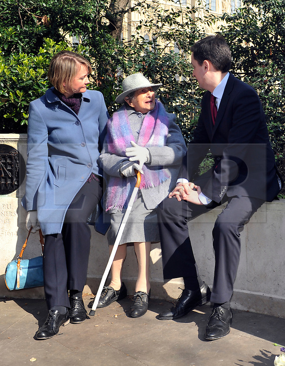 ©London News pictures. 08/03/11. 105-year-old former suffragette Hetty Bower (C) meets Labour Leader Ed Miliband (R) and Shadow Home Secretary Yvette Cooper (L) at the statue of Emmeline Pankhurst to mark International Women's Day. She was  joined by Labour Leader Ed Miliband, Labour Deputy Leader Harriet Harman, and shadow home secretary Yvette Cooper. Emmeline  at the Pankhurst statue at Victoria Tower Gardens, Parliament Square, Westminster, London, Picture Credit should read Stephen Simpson/LNP