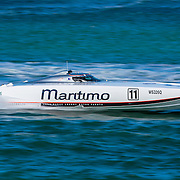 Maritimo 11 looks for clear water in her pursuit of the leaders, Inboard Engine Class, in the Offshore Superboat Championships Coffs Harbour, New South Wales, Australia