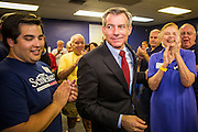 28 AUGUST 2012 - PHOENIX, AZ:  Rep. DAVID SCHWEIKERT (R-AZ) works his way through the crowd to make his victory speech at his campaign office in Phoenix Tuesday night. Schweikert faced Congressman Ben Quayle in what was the hardest Republican primary election in Arizona in 2012. Both were incumbent Republican freshmen elected to Congress from neighboring districts in 2010. They ended up in the same district at the end of the redistricting process and faced off against each other in the primary to represent Arizona's 6th Congressional District, which is made up of Scottsdale, Paradise Valley and parts of Phoenix. The district is solidly Republican and the winner of the primary is widely expected to win November's general election. Both are conservative Republicans with Tea Party backing.   PHOTO BY JACK KURTZ