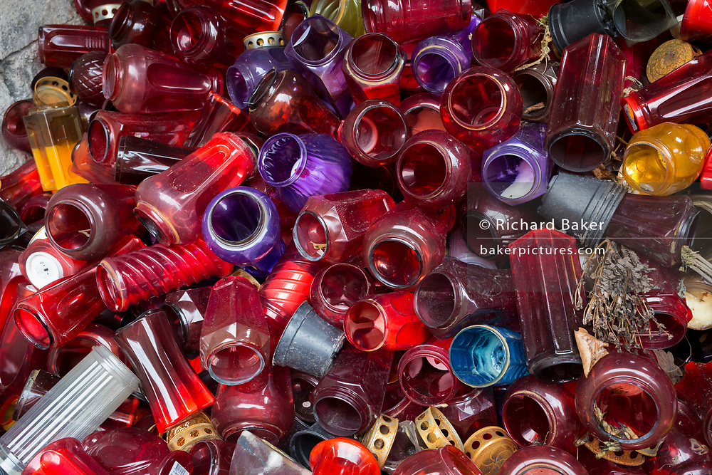 Discarded glass from graves, piled up in a communal cemetery bin of a rural village in the Kozjansko Regional Park, on 24th June 2018, in Prevorje, Slovenia.