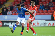 Walsall defender Jon Guthrie (5) holds up Oldham Athletic striker Aaron Amadi-Holloway (10) 1-1 during the EFL Sky Bet League 1 match between Walsall and Oldham Athletic at the Banks's Stadium, Walsall, England on 12 August 2017. Photo by Alan Franklin.