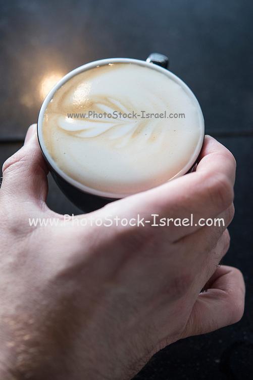 Barista prepares a cup of cappuccino