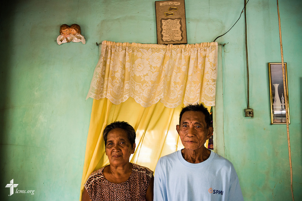 LCMS disaster dollars from donors helped this family, who posed for a portrait at their home in Mayahag, Leyte Province, Philippines, on Saturday, March 15, 2014. The family lost a majority of their coconut crop and income from Typhoon Haiyan. LCMS Communications/Erik M. Lunsford