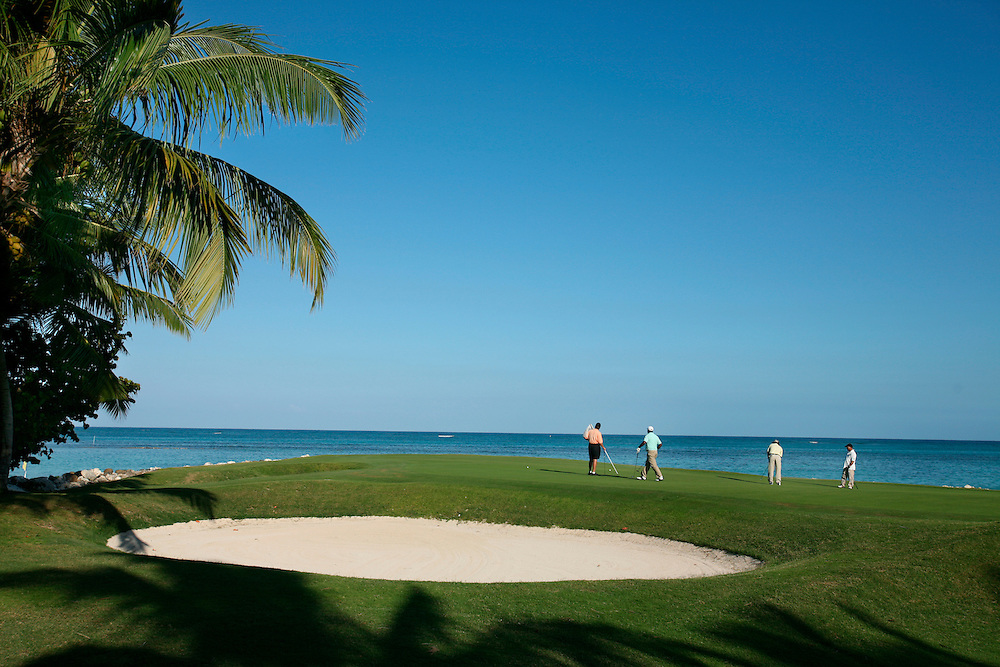 Punta Cana, Dominican Republic - April 11: Golfers put on a hole near the ocean on the Punta Cana Golf Course at the Punta Cana resort, in the Dominican Republic, April 11, 2007.