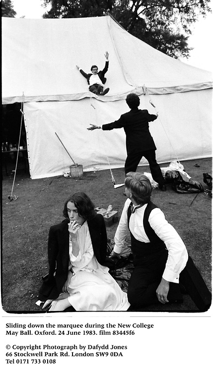 Sliding down the marquee during the New College May Ball. Oxford. 24 June 1983. film 83445f6<br />© Copyright Photograph by Dafydd Jones<br />66 Stockwell Park Rd. London SW9 0DA<br />Tel 0171 733 0108