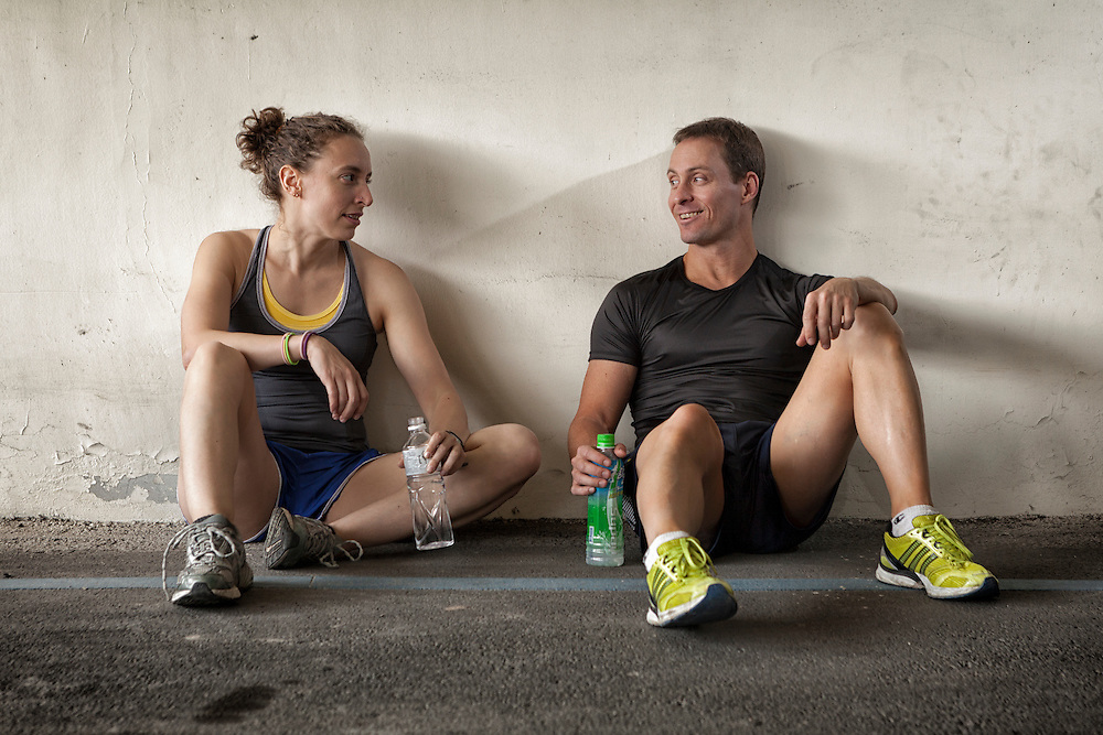Two athletes talking while they recover after exercise.