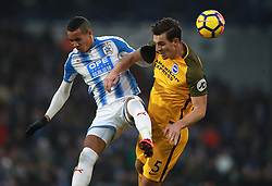 Huddersfield Town's Tom Ince (left) and Brighton & Hove Albion's Lewis Dunk battle for the ball during the Premier League match at the John Smith's Stadium, Huddersfield.