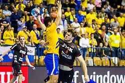 Golla Johannes of SG Flensburg-Handewitt and Razgor David of RK Celje Pivovarna Lasko during handball match between RK Celje Pivovarna Lasko (SLO) and SG Flensburg Handewitt (GER) in 3rd Round of EHF Men's Champions League 2018/19, on September 30, 2018 in Arena Zlatorog, Celje, Slovenia. Photo by Grega Valancic / Sportida