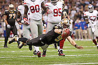 28 November 2011: Quarterback (9) Drew Brees of the New Orleans Saints runs the ball and dives into the endzone for a touchdown against the New York Giants during the second half of the Saints 49-24 victory over the Giants at the Mercedes-Benz Superdome in New Orleans, LA.